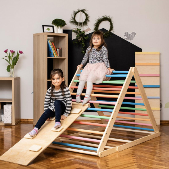 Children sitting on a triangle climber toy with a rock board