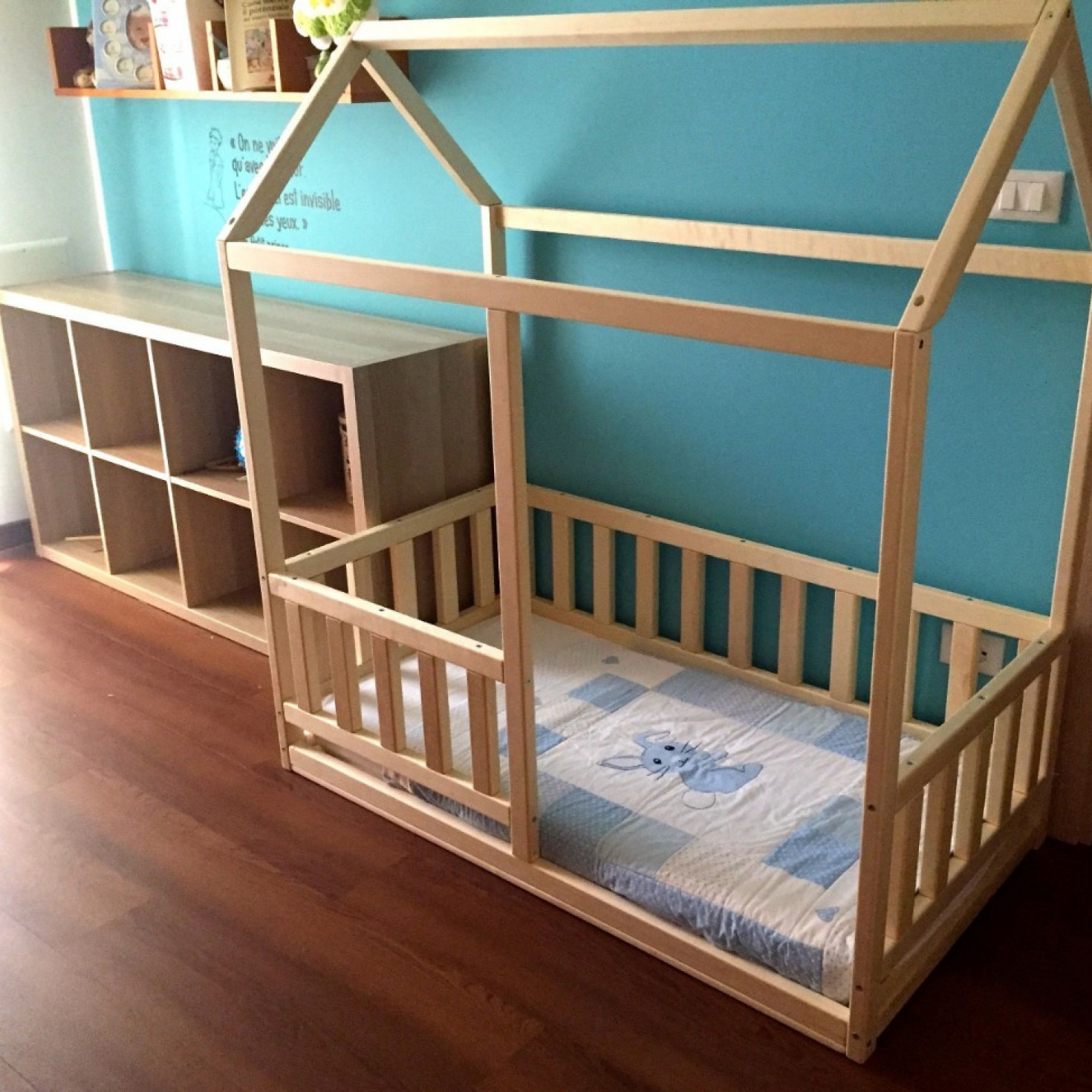 A kids floor bed with a mattress
