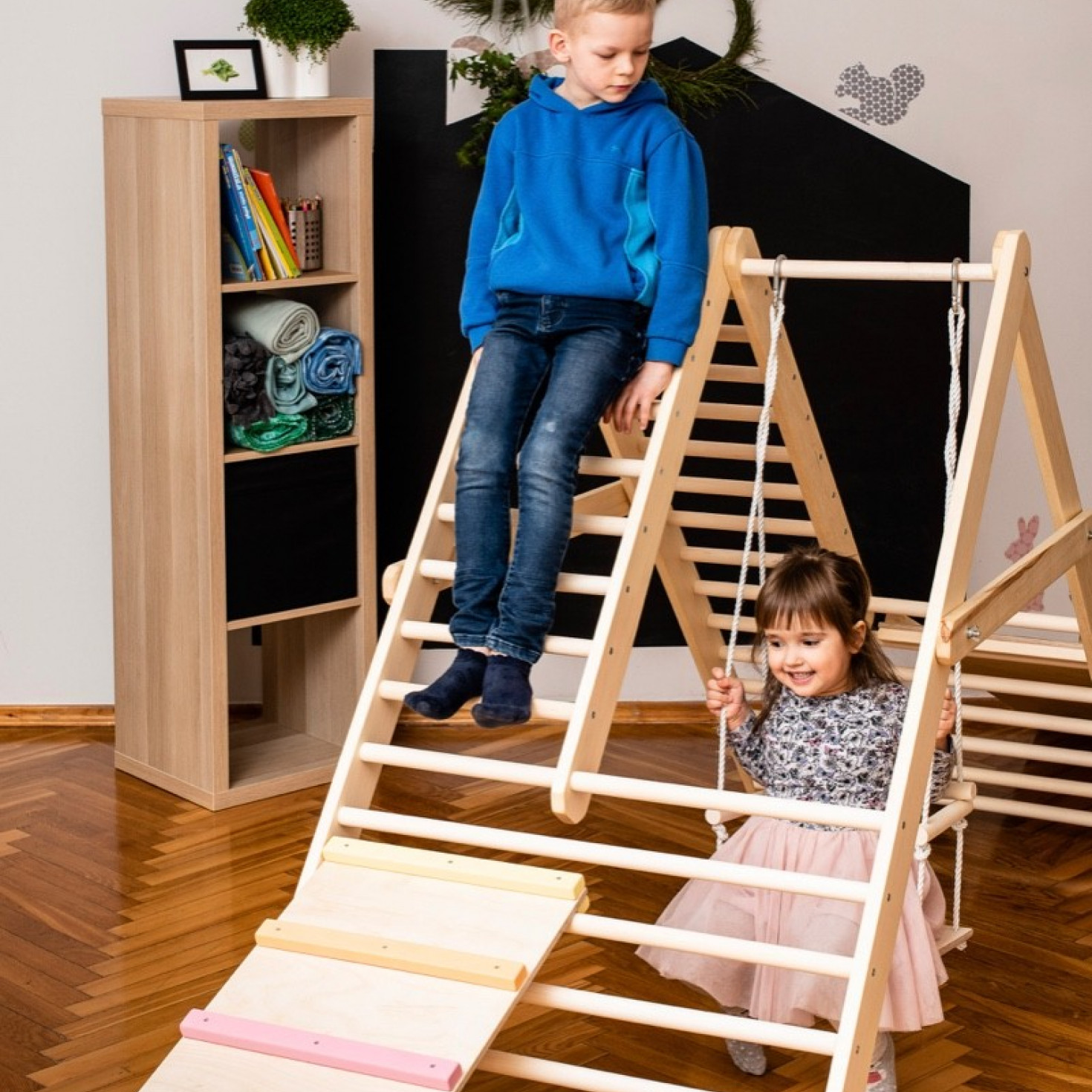 Children having fun on a climbing ladder
