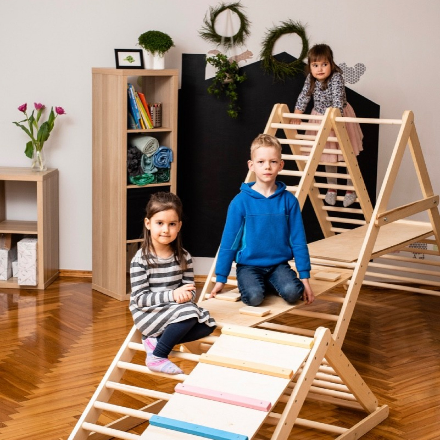 Children playing on a climbing ladder