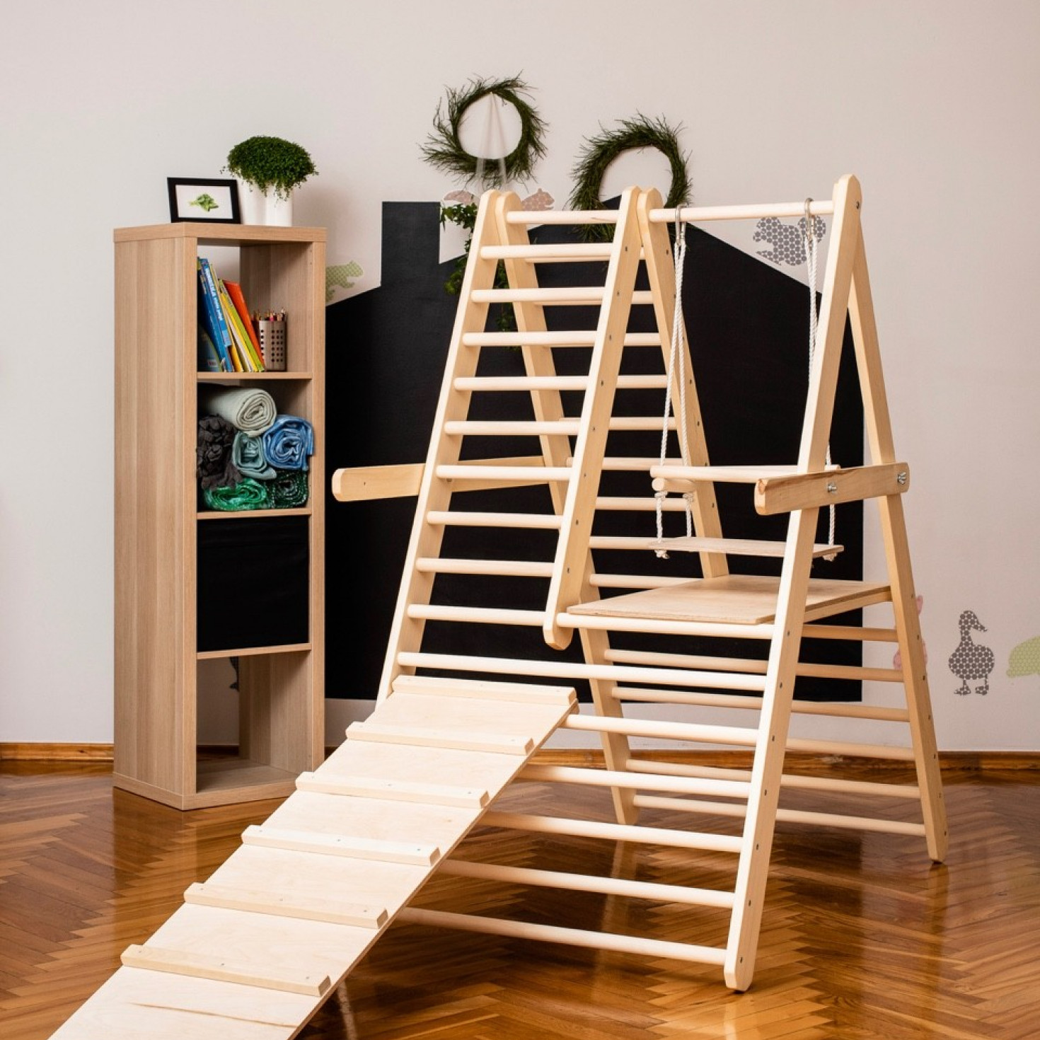 A climbing triangle for toddlers with a slide board