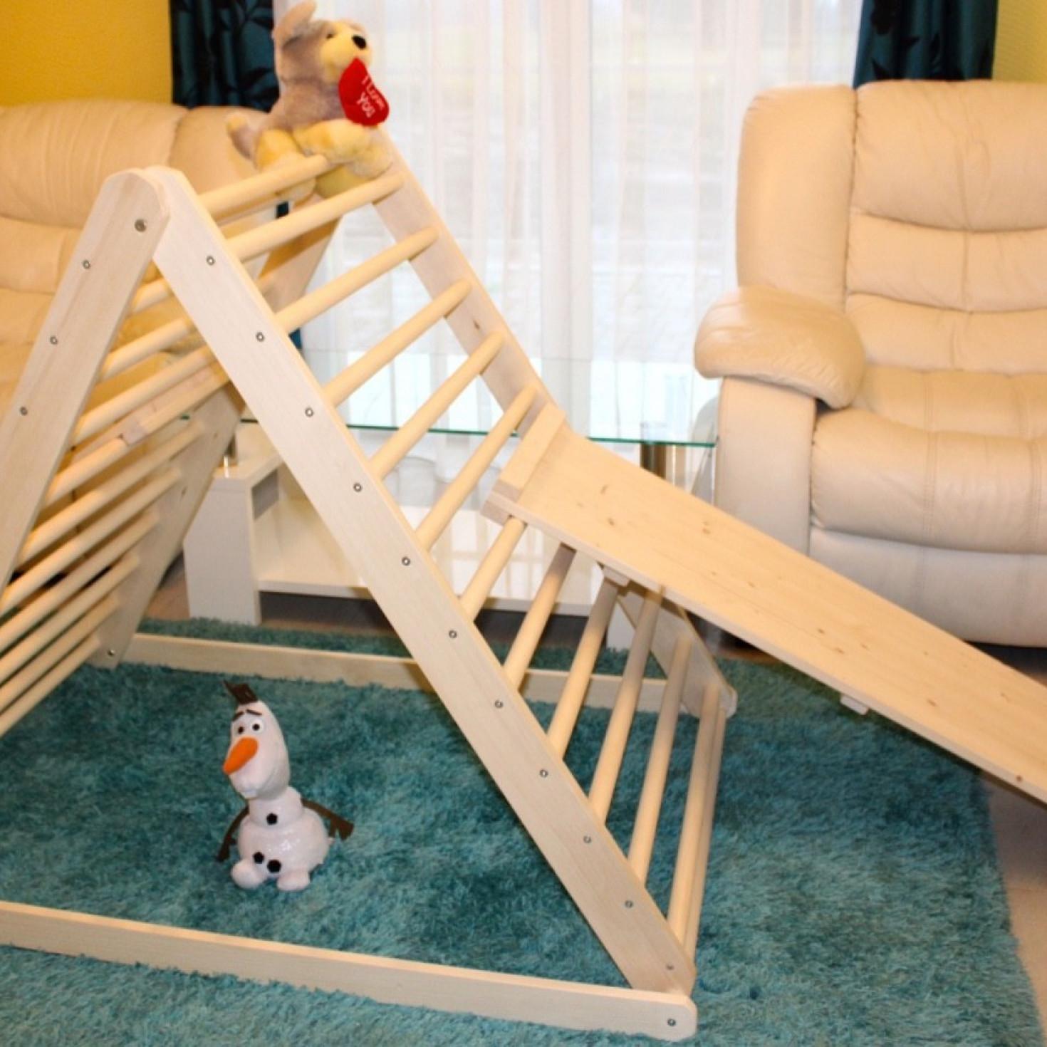 An indor wooden climbing frame with slide